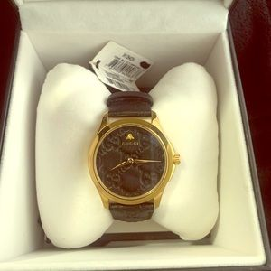 Gucci unisex black leather and gold watch